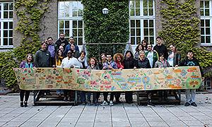 Teilnehmer*innen mit conference painting